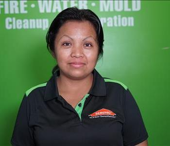 Woman in front of SERVPRO logo